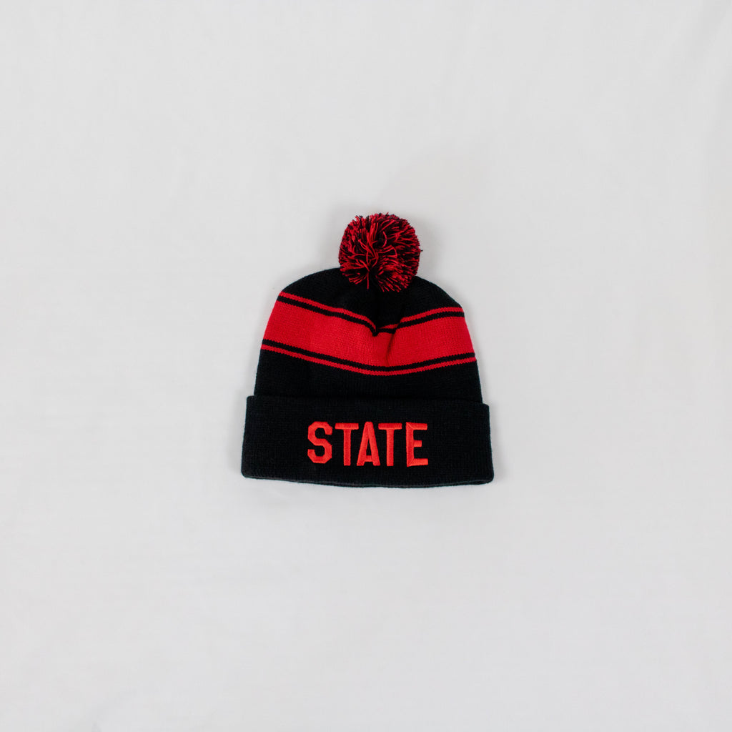 black and red striped beanie with a two-tone pom on top STATE embroidered in red on front fold