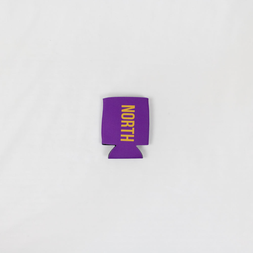 a purple collapsable foam koozie with north in gold down the front
