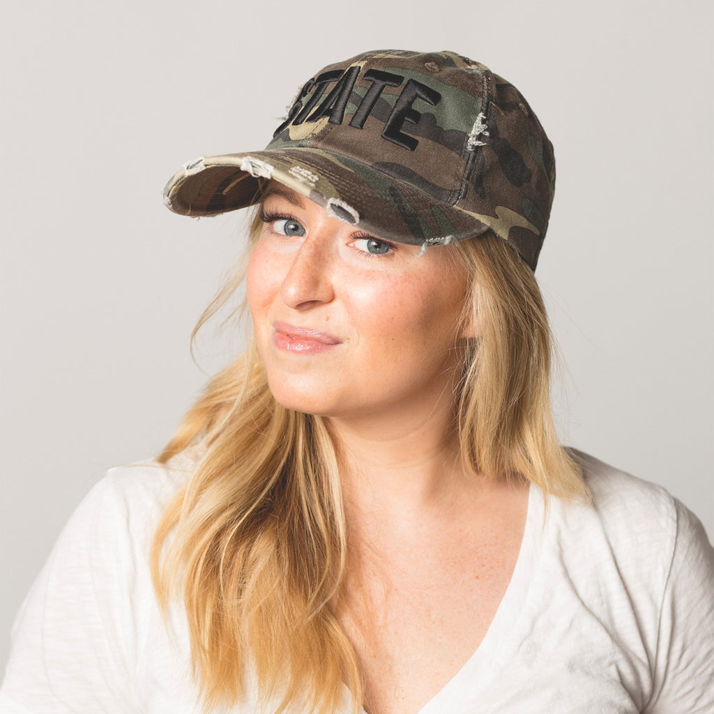 front view on model STATE Distressed Baseball Hat camo