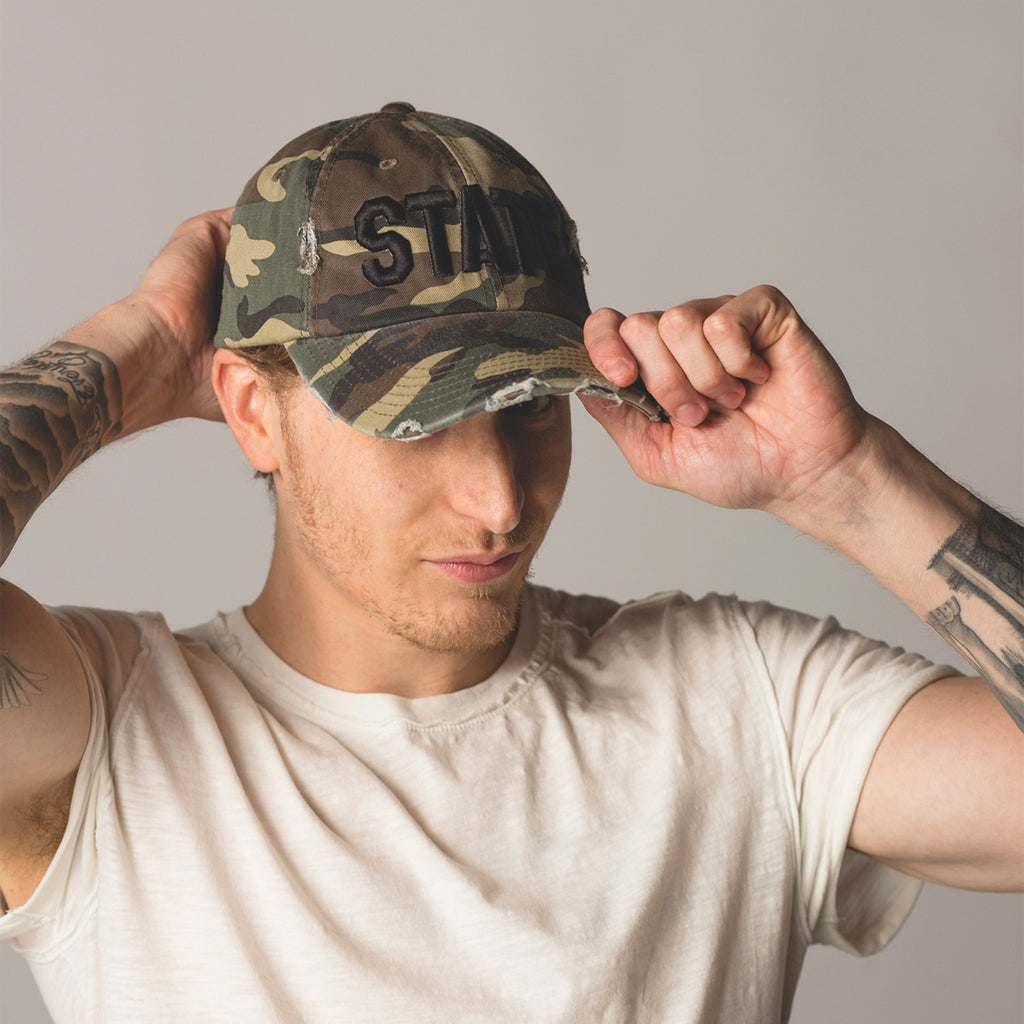 alt front view on model STATE Distressed Baseball Hat camo