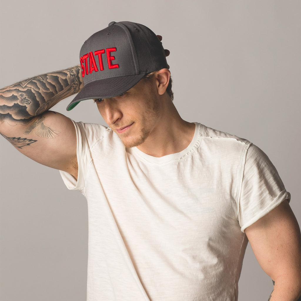 front view on model STATE Flat Bill Snapback Hat gray