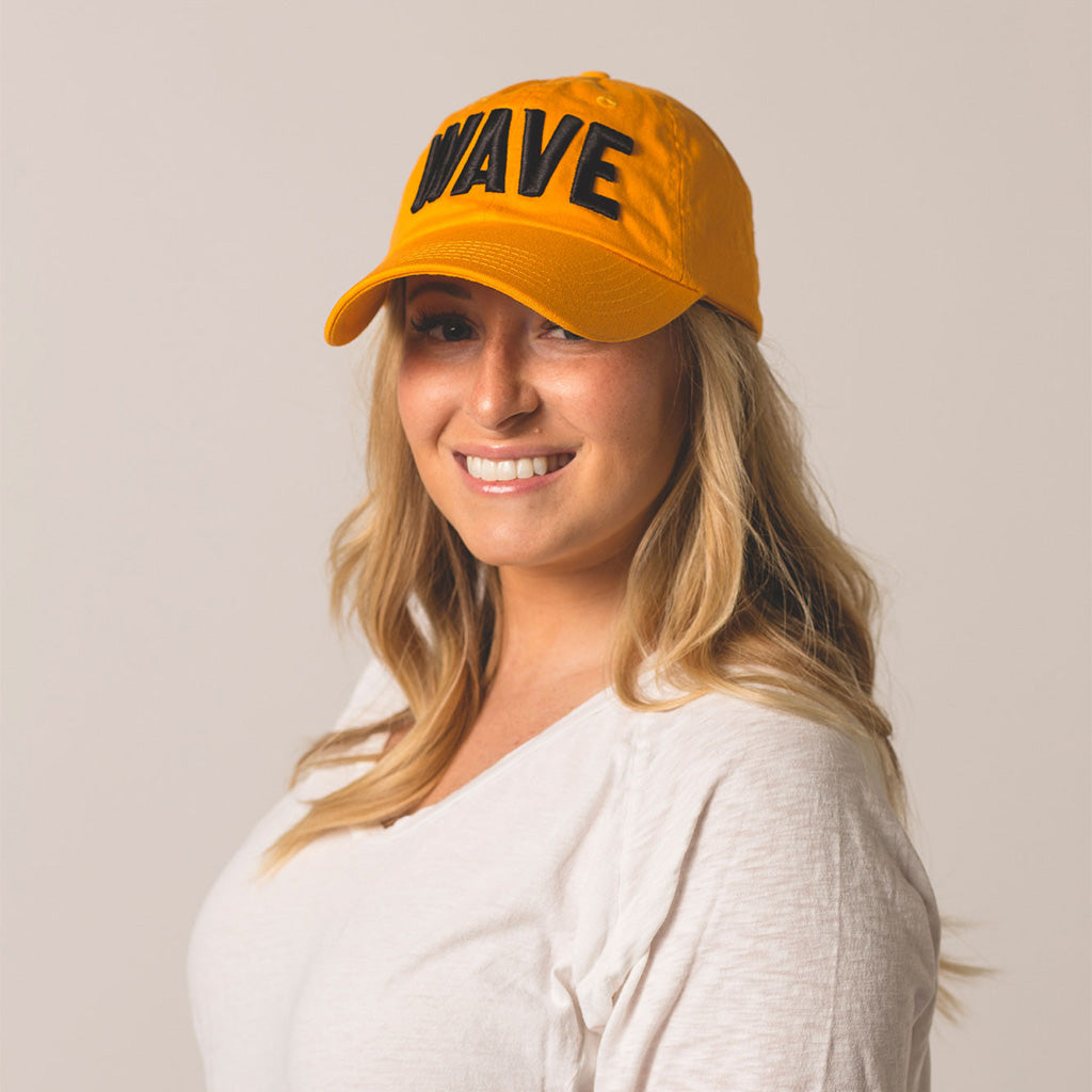 front view on model WAVE gold hat