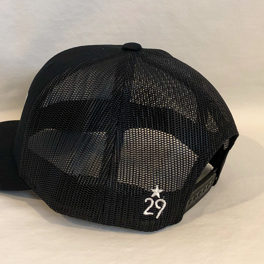 all black trucker hat meshback showcasing the 29th State Apparel logo on back left panel next to plastic adjustment closure