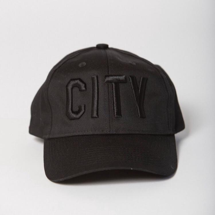 front view of black baseball hat with black CITY embroidered on the front