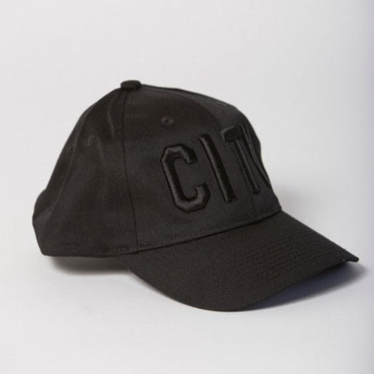 side view of black baseball hat with black CITY embroidered on the front