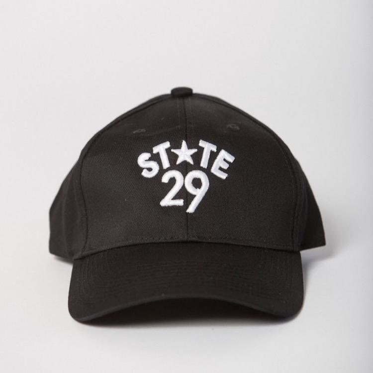 front view of black baseball hat with 29th state apparel logo embroidered on the front center in white