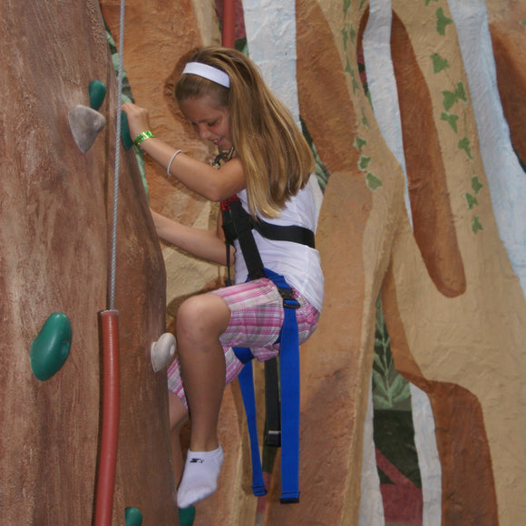 Rock Wall at ZDT's Amusement Park - Small girl climbing a 25-foot indoor rock wall.