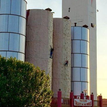 Silo Climb at ZDT's Amusement Park - Two climbers attempt to climb outdoor 60-foot climbing wall.
