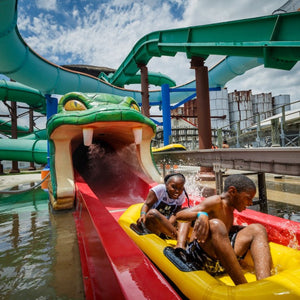 The Viper at ZDT's Amusement Park - Two children emerge riding in a raft from the viper water slide.