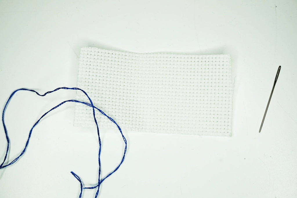 How to cross stitch fabric and threading a needle