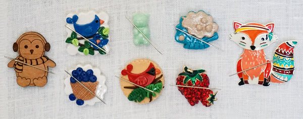Needle minders for embroidery or cross stitch