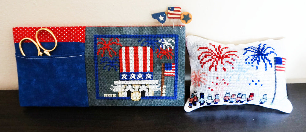 Two patriotic cross stitch pieces displayed