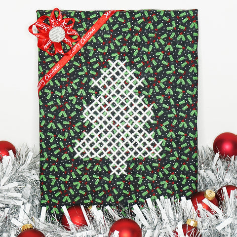 Christmas Tree Cross Stitch project surrounded by ornaments