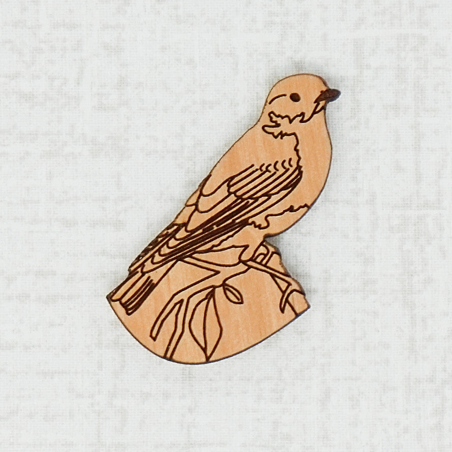 Bird wooden needle minder top view