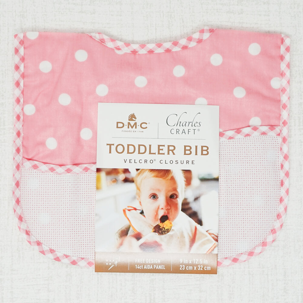 Pink Polka Dot Toddler Bib shown with product tags