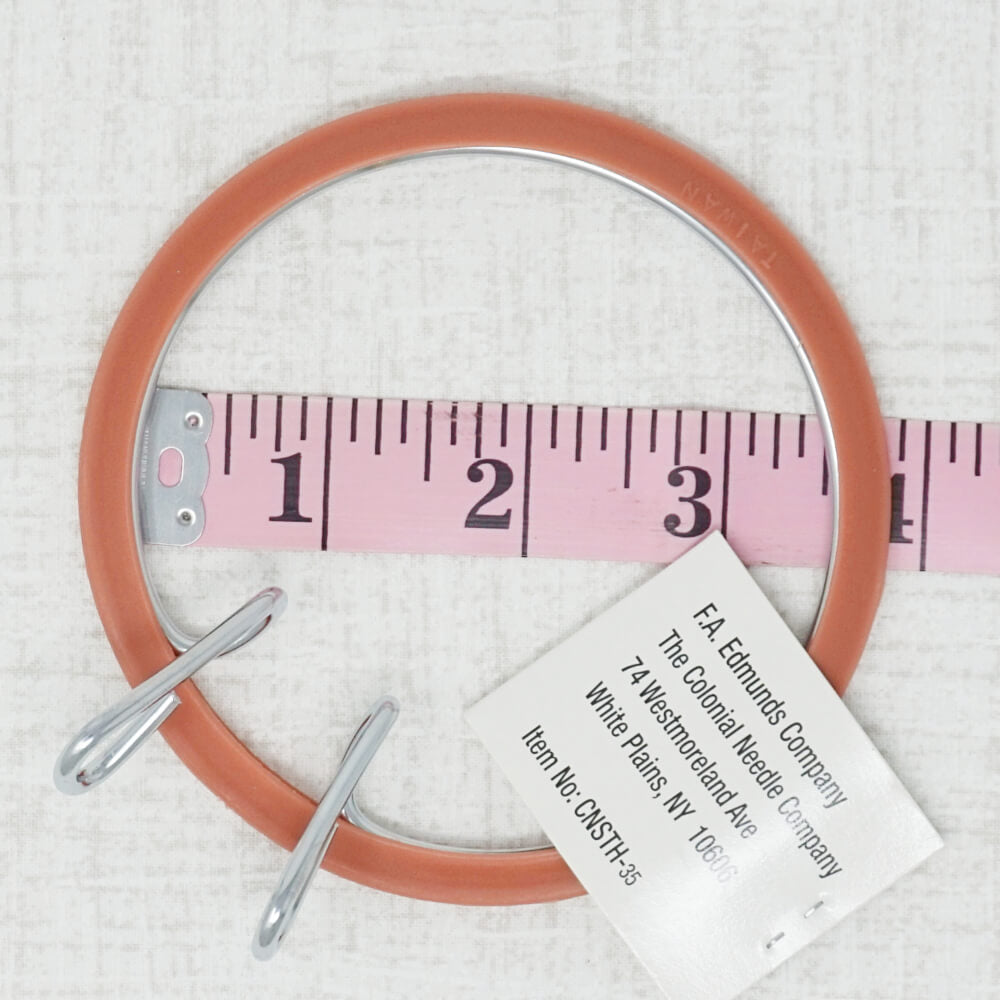 3.5 inch spring embroidery hoop with measuring tape shown