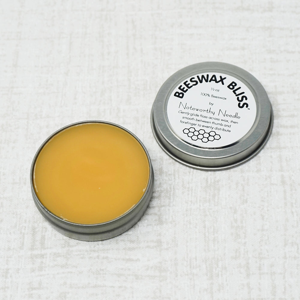 open container of beeswax bliss container