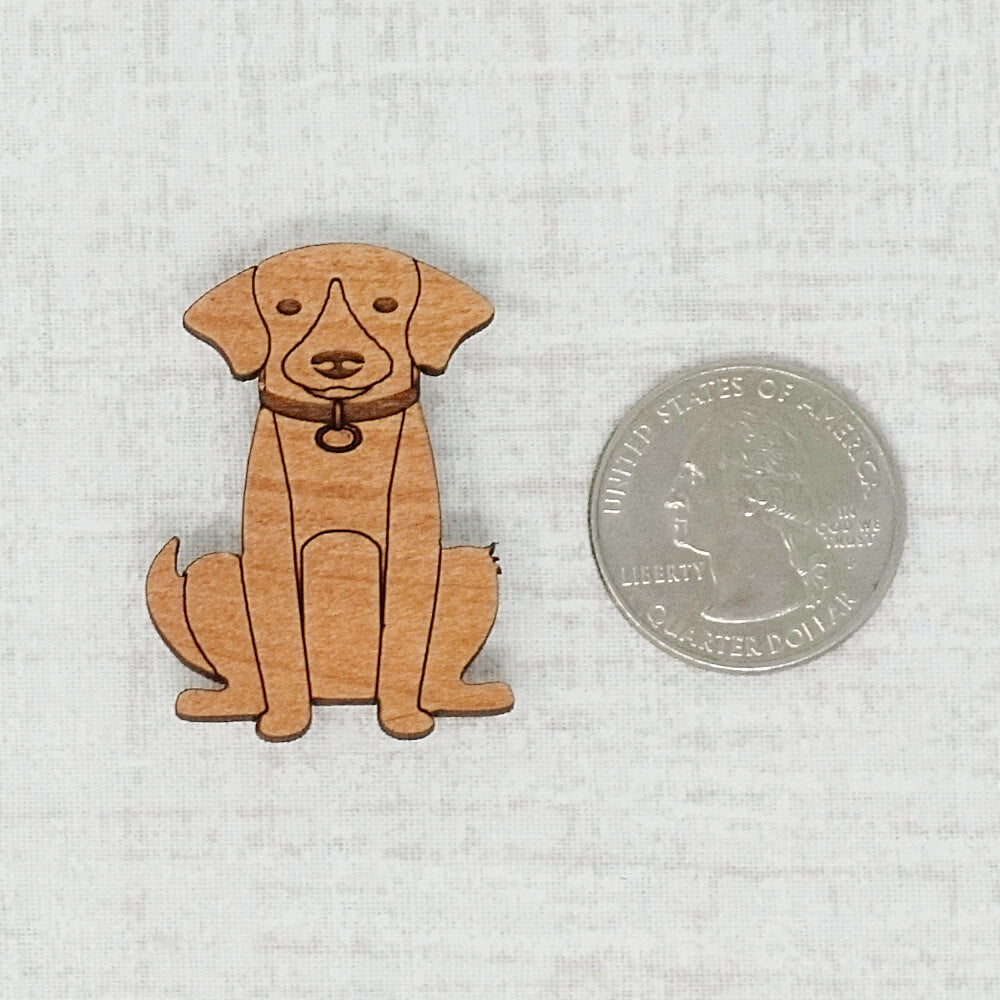 Dark Dog Needle Minder next to a quarter