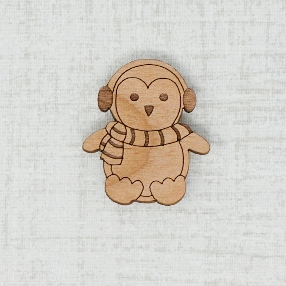 Dark wooden penguin needle minder by joseph's wookshop