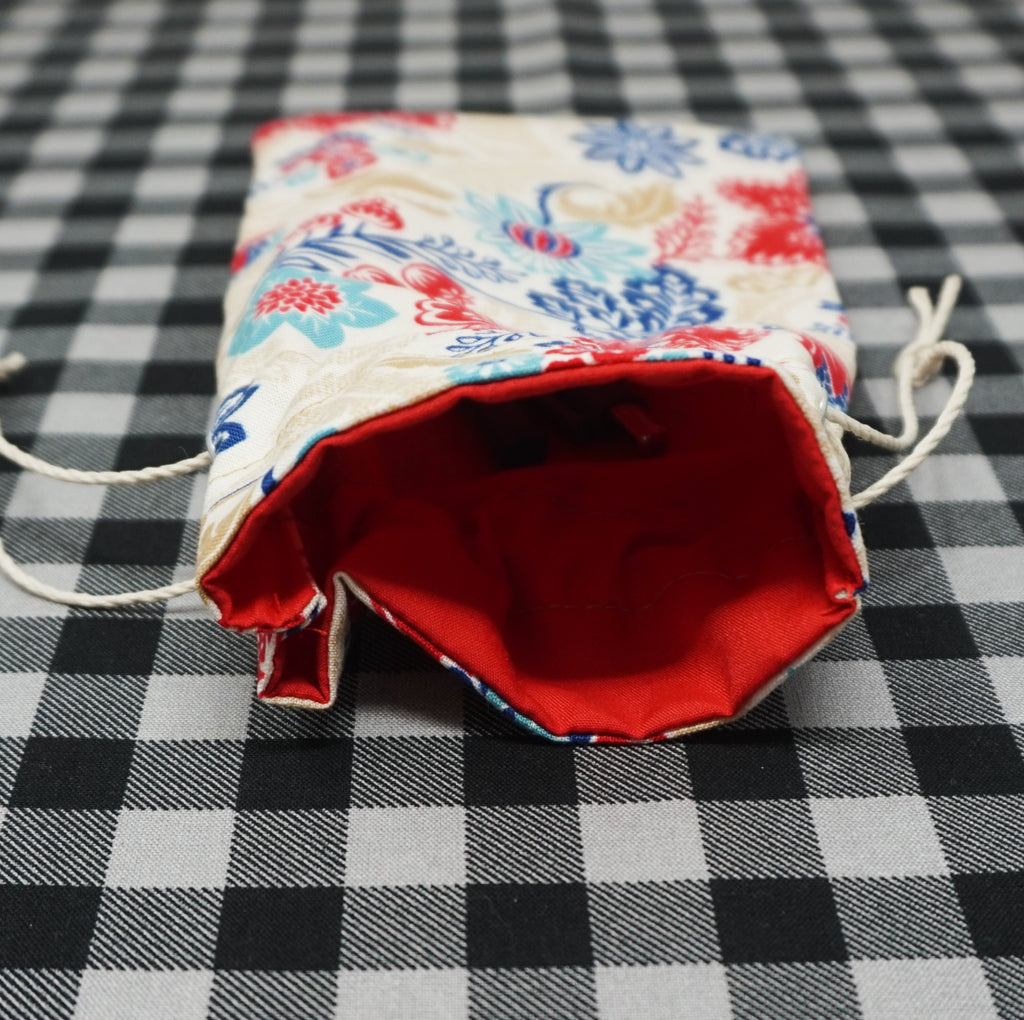 red inside of red and blue floral drawstring bag for sewing notions