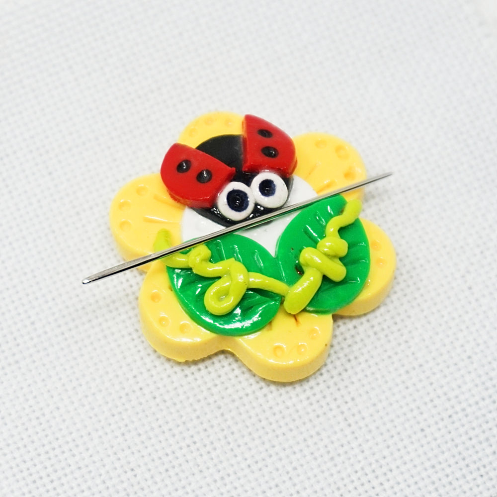 ladybug needle minder with a needle