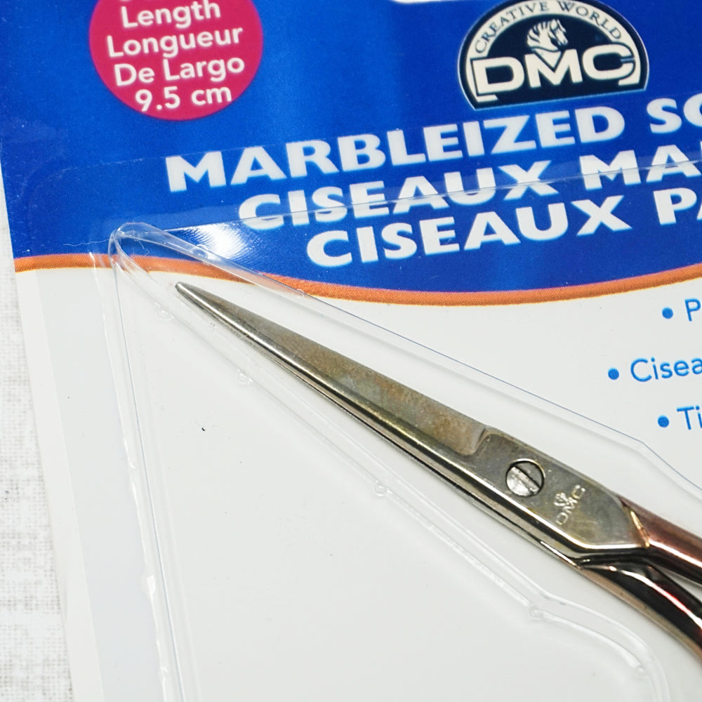 DMC marbleized embroidery scissors close up of blades