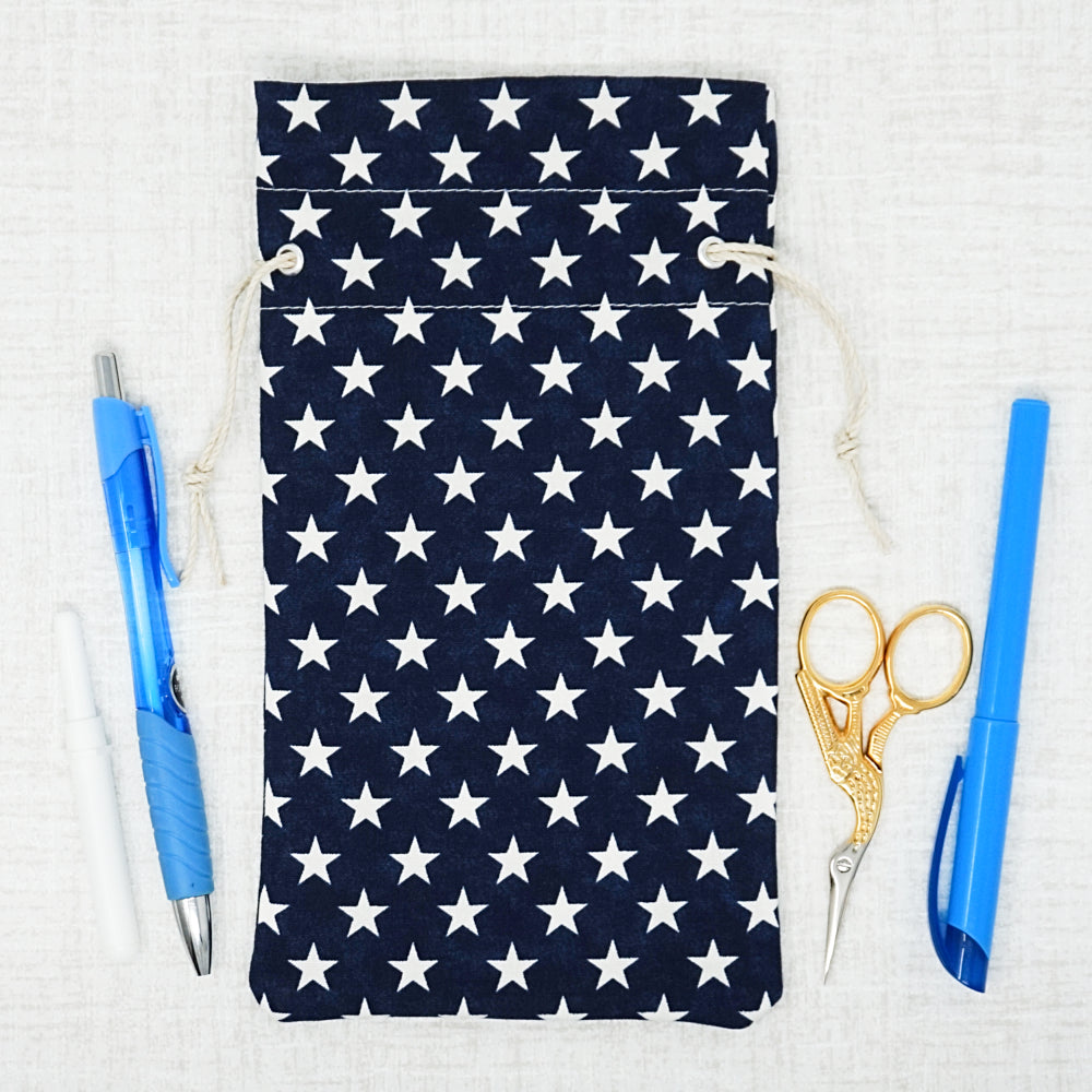 navy, stars bag surrounded by cross stitch accessories