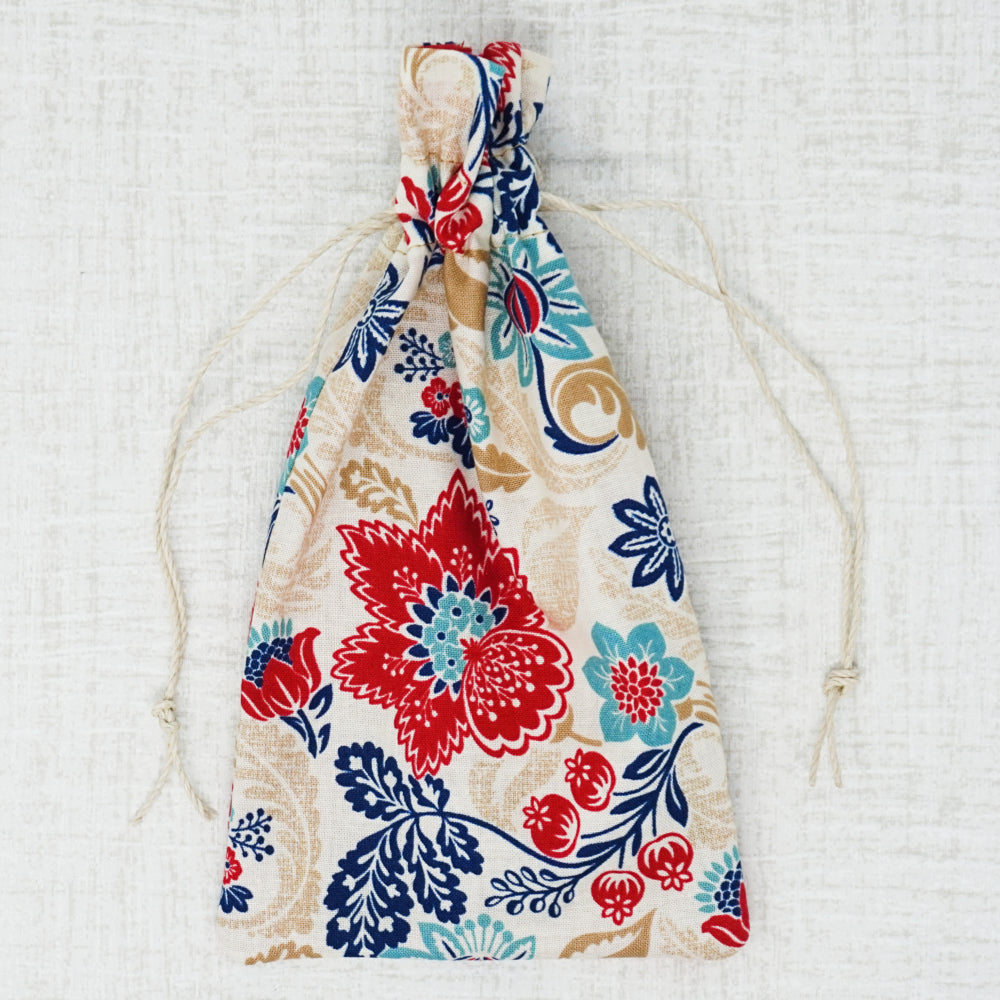red and blue floral drawstring bag for sewing notions