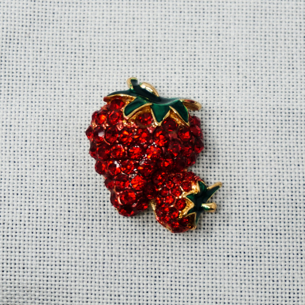 strawberry needle minder on linen by accoutrement designs