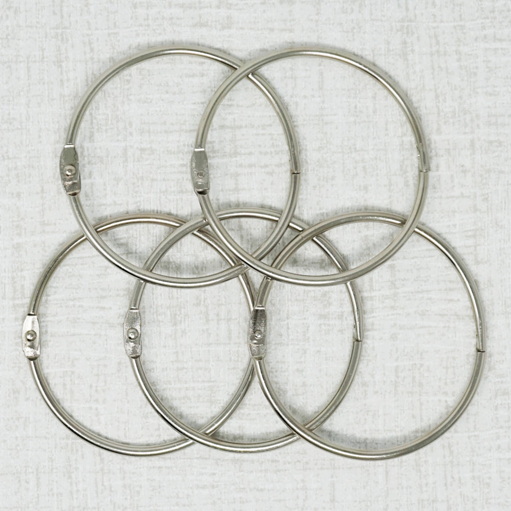 Five three inch metal rings