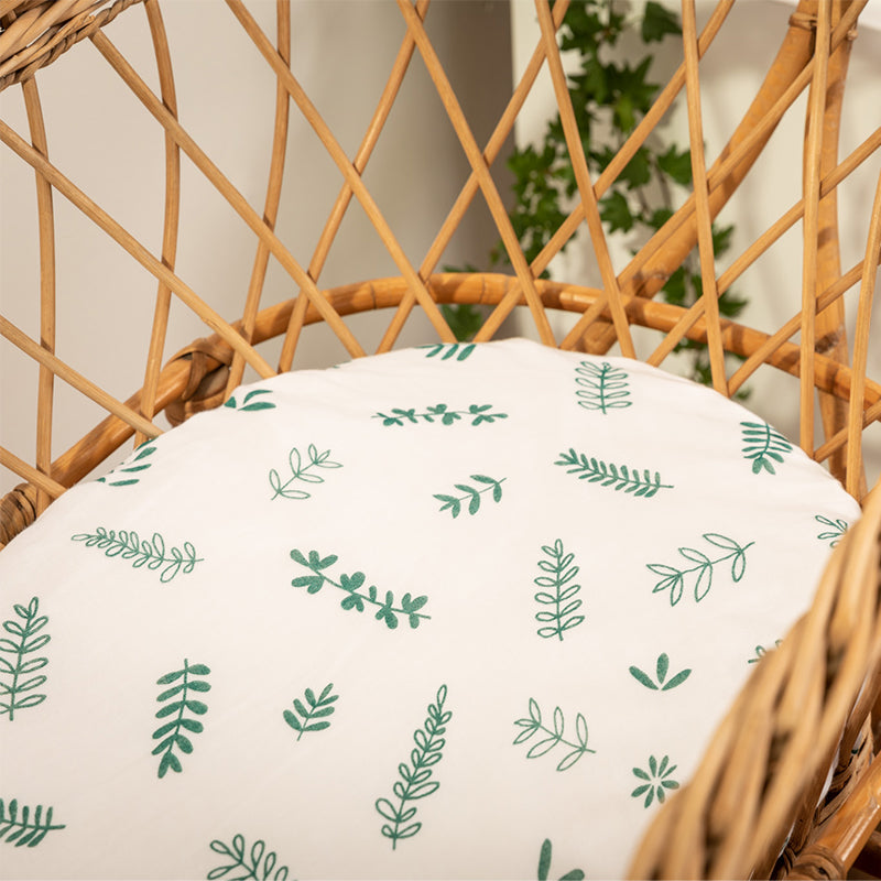 Hand illustrated New Zealand forest inspired printed fitted bassinet sheet printed in a moss green