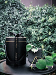 Matte black pot with a terrazzo look base with various plant options