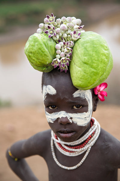 A Mursi girl with flower