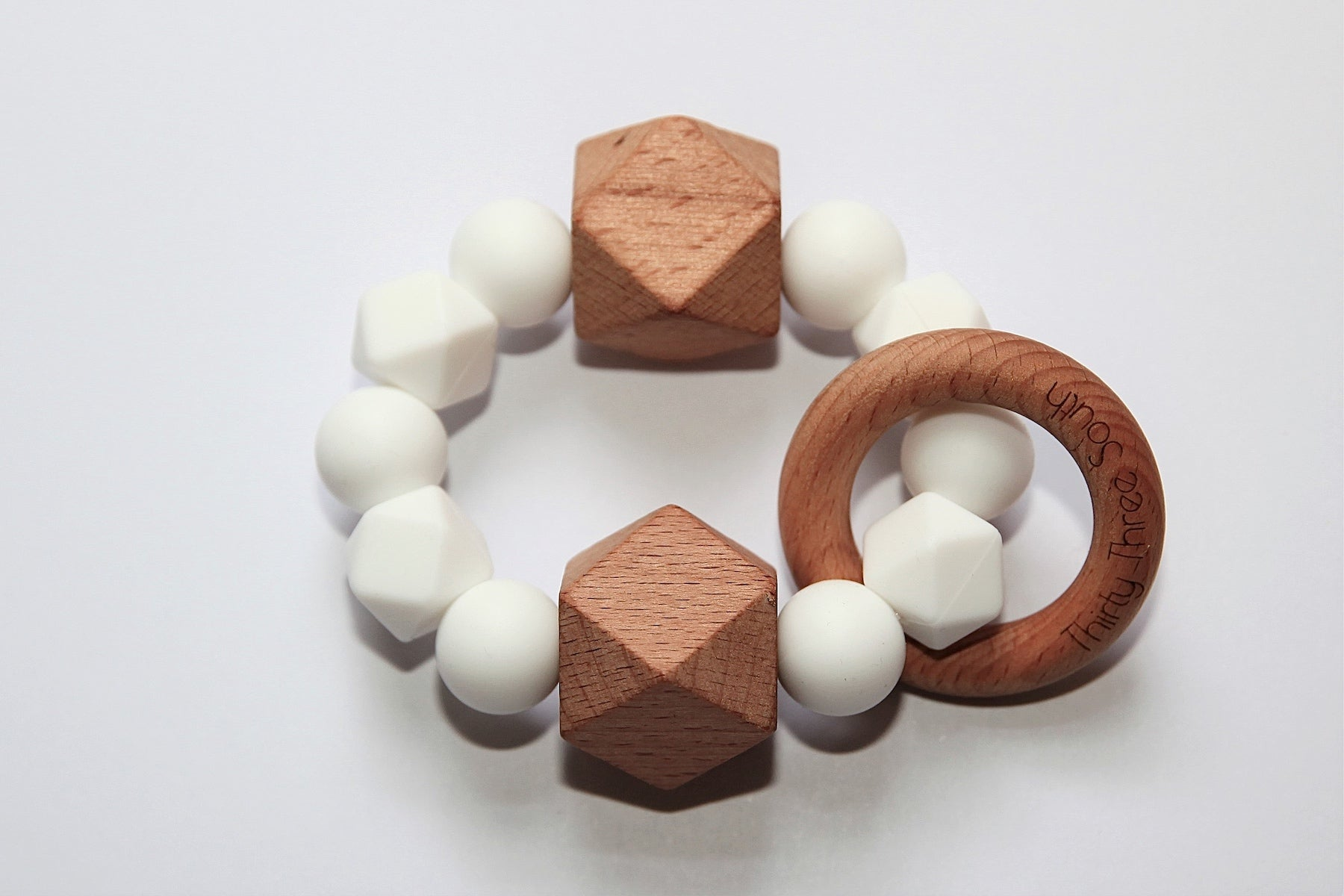 Thirty Three South Wooden Teethers Fez White