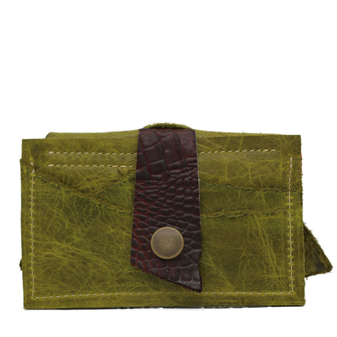 Leather clutch wallet securing cards and business cards. Made using sustainable leather other designers often throw away. Secure business cards in the back hold up to 7 credit cards front and back