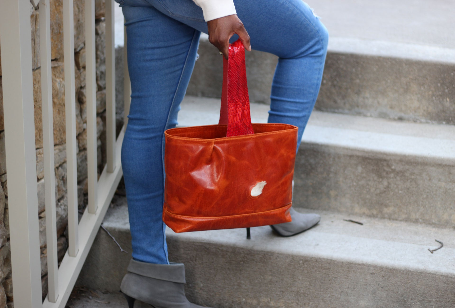 Unique purses made using sustainable leather and flawed hide celebrating individualism. Key hook, deep zipper and pouch pockets for organization, and security. Own your style every bag tells a story
