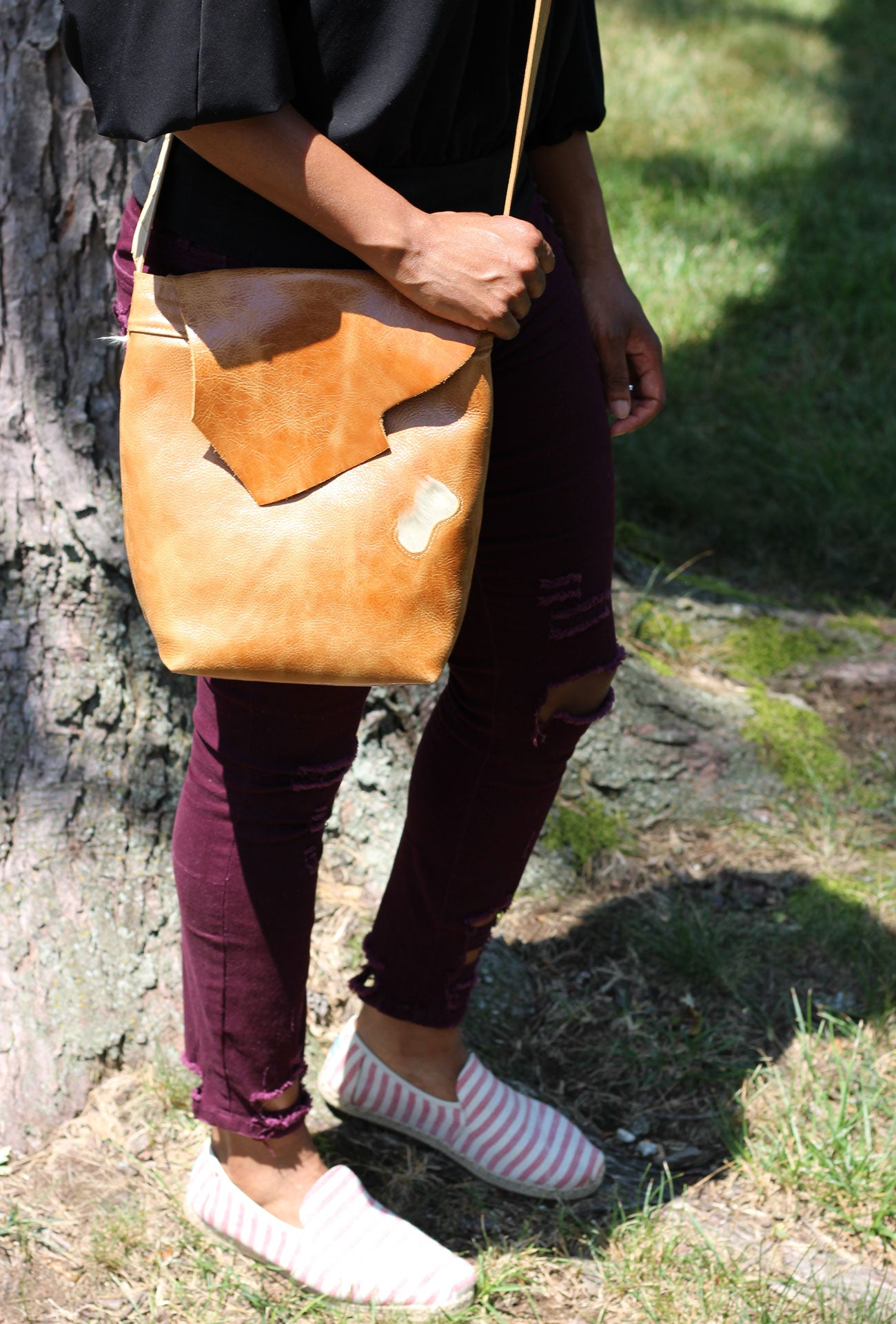 Crossbody leather purses. Soft leather handbags distressed cowhide and hair on genuine leather designed using sustainable leather distressed cowhide