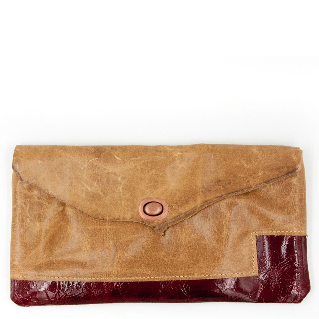 Clutch bag made using recycled leather unique, and artistic vintage hardware Tandy leather. We use flawed and sustainable leather. Our clutches celebrate imperfection and individualism with a message of beauty coming from within.