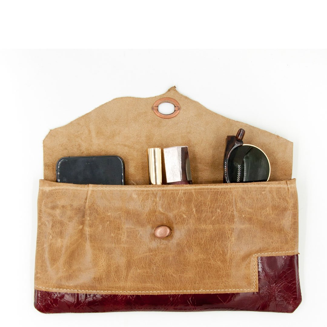 Clutch purse made using recycled leather unique, and artistic vintage hardware Tandy leather. We use flawed and sustainable leather. Our clutches celebrate imperfection and individualism with a message of beauty coming from within.