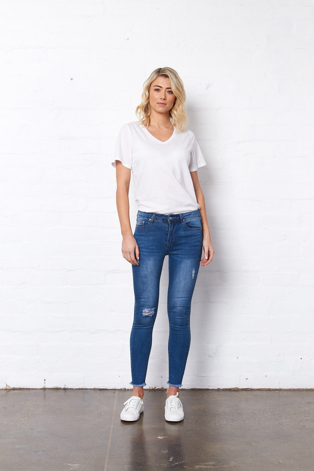 Lucia Jeans by Saint Rose. Blue with rips.
