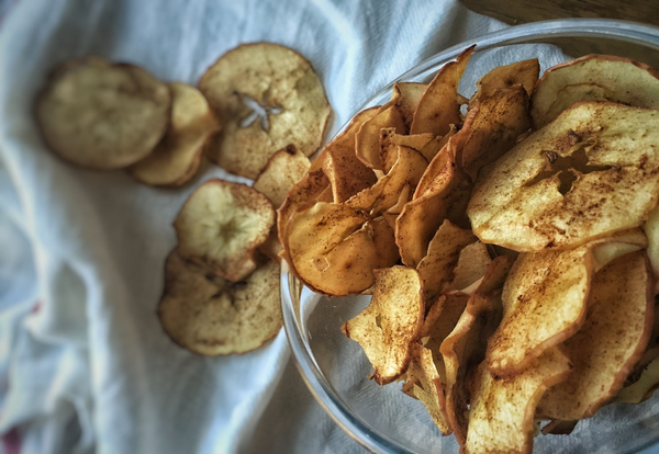 Bowl of sweet dried apple chips with cinnamon