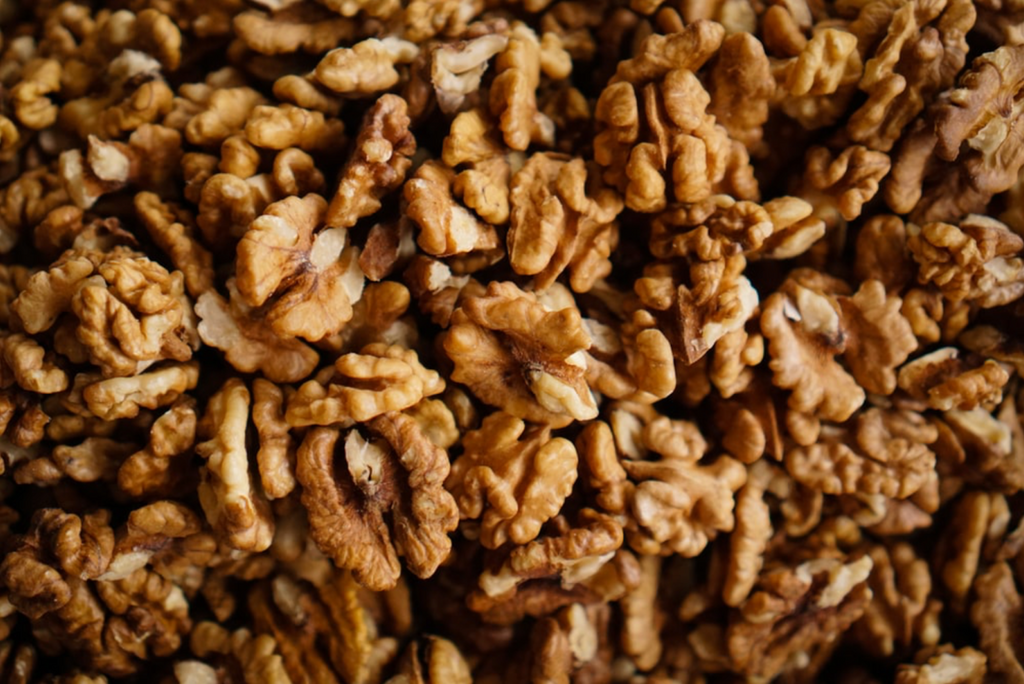 Whole roasted walnuts containing arginine that removes ammonia