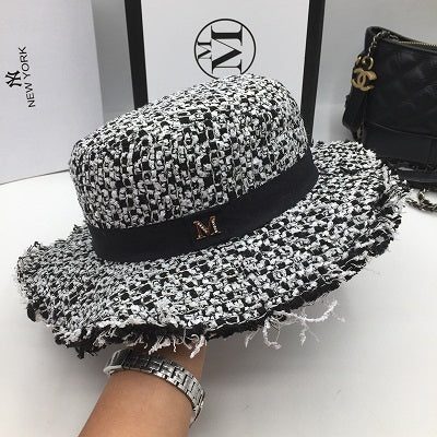 101aab8398e21 Fashion flat-topped hat black and white knitting small letters hat fashion  tassel wide brim