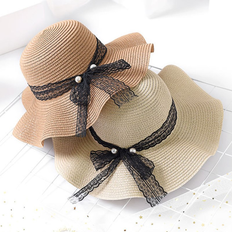 8e4190abe37b7 HT1690 New Summer Hat Black Lace Band Pearl Straw Beach Hat Female Solid  Packable Bucket Panama Hat Floppy Wide Brim Sun Hat