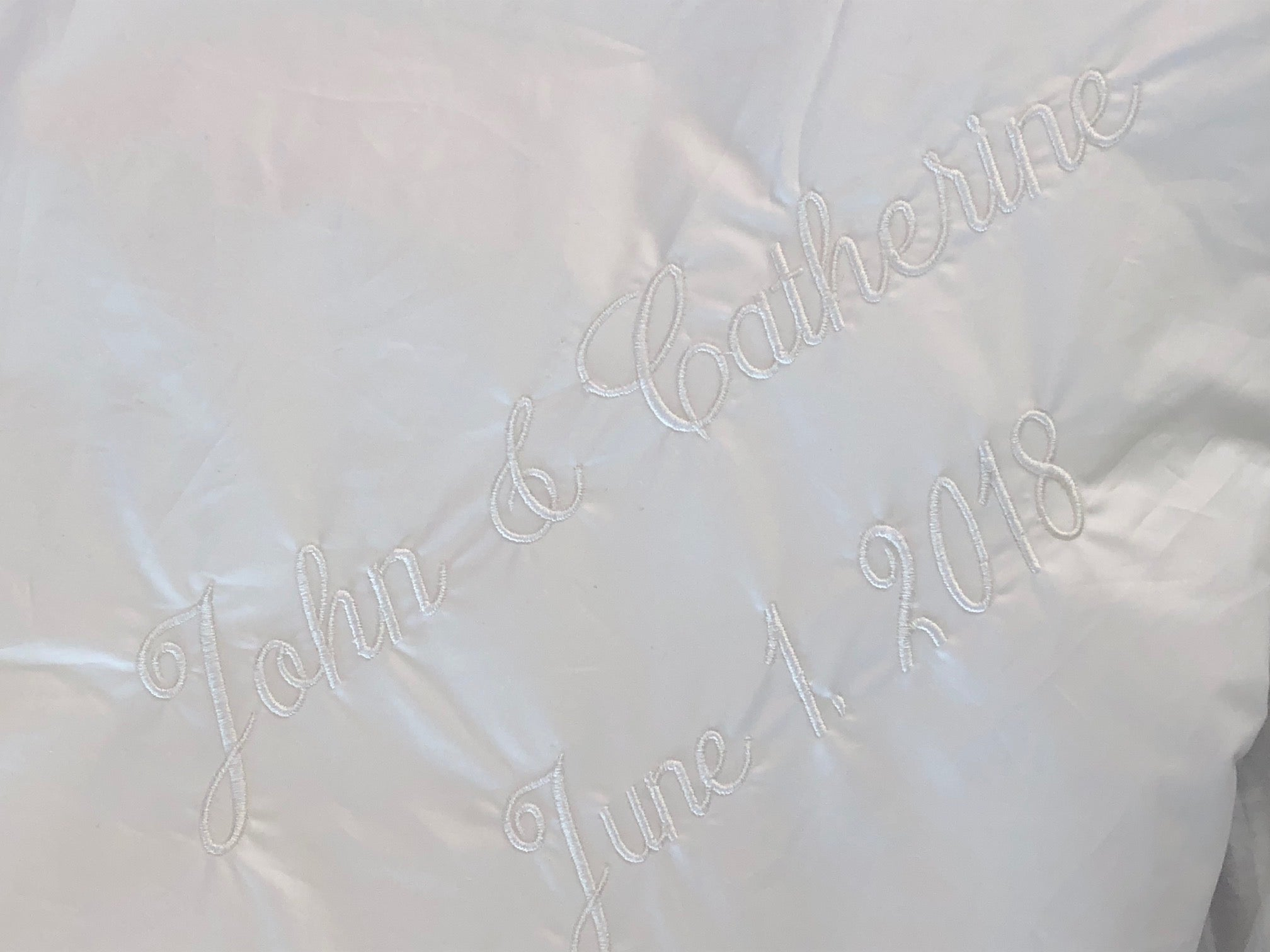 Embroidery on duvet with names and wedding date
