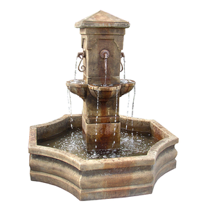 Concrete courtyard water fountain with metal spouts