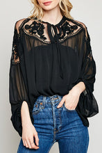 Women's black sheer lace detail special occasion top.