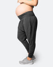 pregnant woman in grey harem maternity pants
