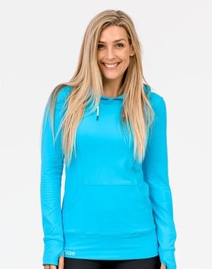 front view of an active mom wearing a sky blue activewear breastfeeding hoodie