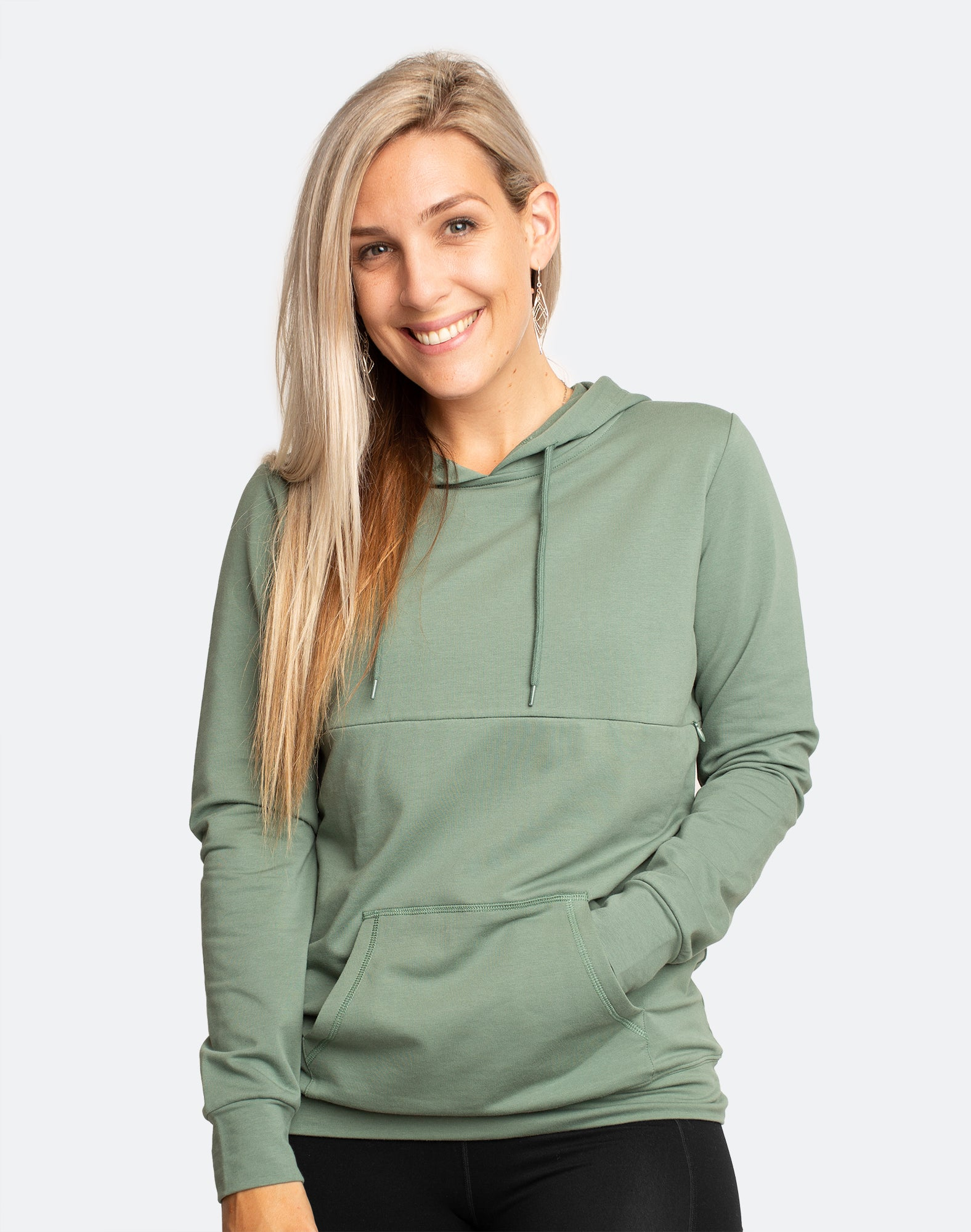 side view of an active mother wearing a khaki breastfeeding hoodie